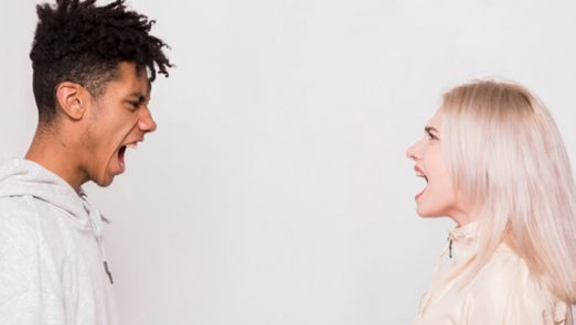 multi-ethnic-young-couple-standing-face-face-screaming-against-whit-background_23-2148151680